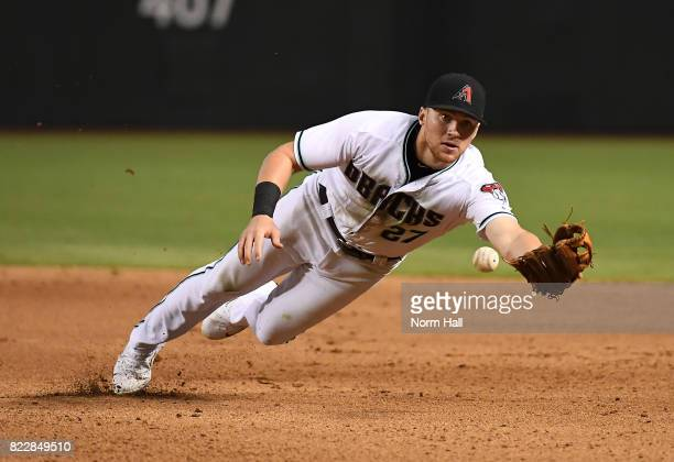 Brandon Drury of the Arizona Diamondbacks attempts to make a diving flip to first base during the ninth inning against the Atlanta Braves at Chase...
