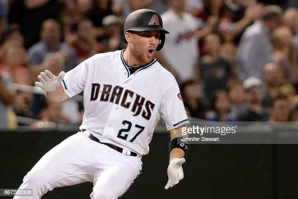 Brandon Drury of the Arizona Diamondbacks celebrates after hitting an RBI triple to deep left during the fifth inning against the Cleveland Indians...