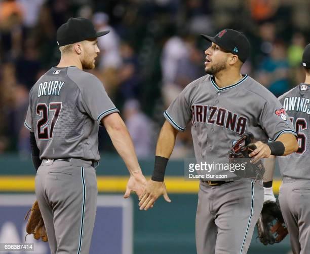 Brandon Drury of the Arizona Diamondbacks celebrates with David Peralta of the Arizona Diamondbacks after a 76 win over the Detroit Tigers at...