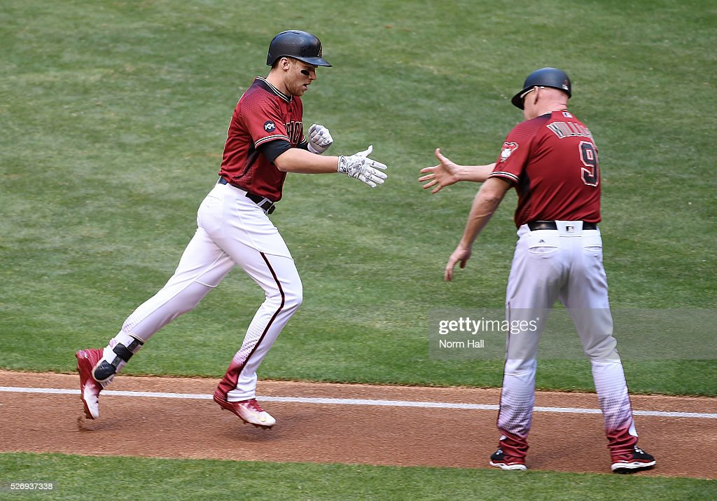 Brandon Drury #27 of the Arizona Diamondbacks celebrates with third base coach Matt Williams #9 after hitting a solo home run during the first inning against the Colorado Rockies at Chase Field on May 01, 2016 in Phoenix, Arizona.