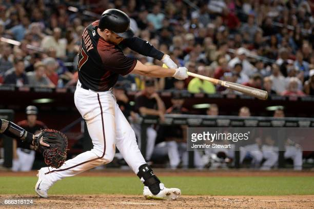 Brandon Drury of the Arizona Diamondbacks doubles to deep left driving in a run during the sixth inning against the Cleveland Indians at Chase Field...