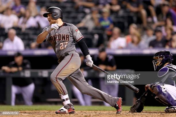 Brandon Drury of the Arizona Diamondbacks hits a 2 RBI single in the ninth inning against the Colorado Rockies at Coors Field on June 21 2017 in...