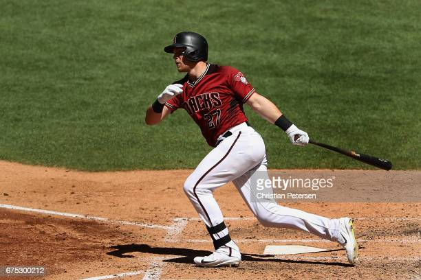 Brandon Drury of the Arizona Diamondbacks hits a double against the Colorado Rockies during the fourth inning of the MLB game at Chase Field on April...