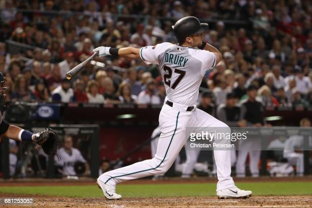 Brandon Drury of the Arizona Diamondbacks hits a RBI ground rule double against the Detroit Tigers during the third inning of the MLB game at Chase...