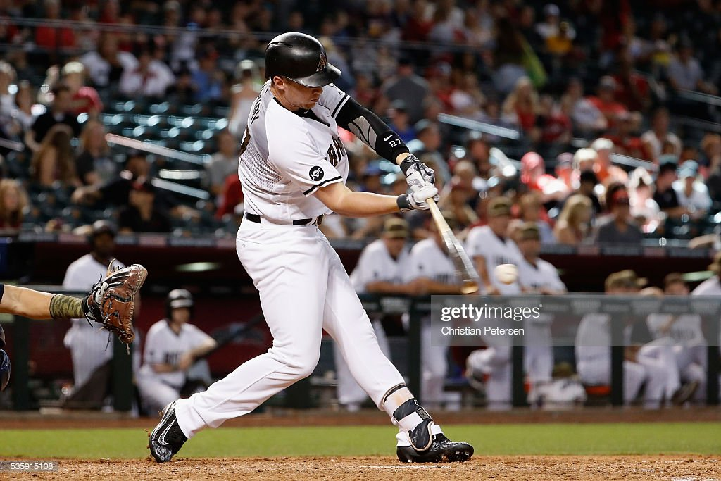 Brandon Drury #27 of the Arizona Diamondbacks hits a single against the Houston Astros during the eighth inning of the MLB game at Chase Field on May 30, 2016 in Phoenix, Arizona.
