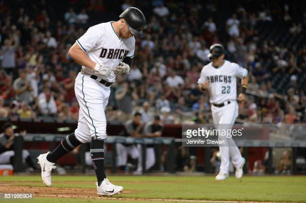 Brandon Drury of the Arizona Diamondbacks is walked as Jake Lamb scores in the fourth inning against the Houston Astros at Chase Field on August 15...