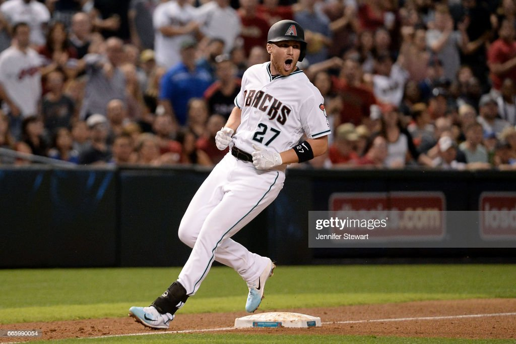 Brandon Drury #27 of the Arizona Diamondbacks reacts after hitting an RBI triple to deep left during the fifth inning against the Cleveland Indians at Chase Field on April 7, 2017 in Phoenix, Arizona.