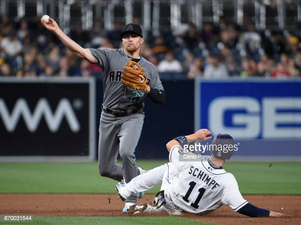 Brandon Drury of the Arizona Diamondbacks throws over Ryan Schimpf of the San Diego Padres to turn a double play during the fourth inning of a...