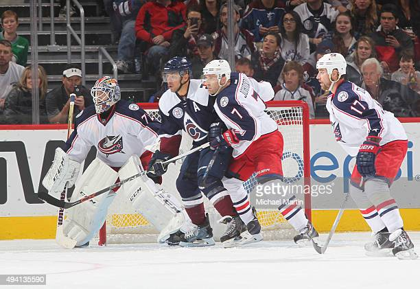 Brandon Dubinsky and Jack Johnson of the Columbus Blue Jackets defend against Jarome Iginla of the Colorado Avalanche at the Pepsi Center on October...