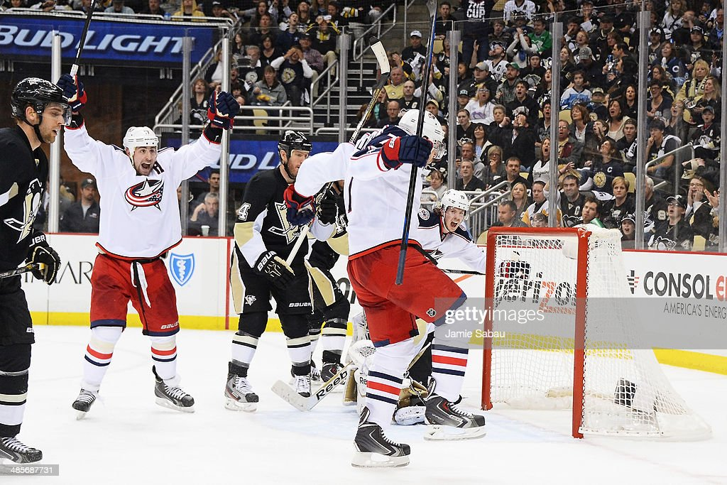 Brandon Dubinsky #17 and Jack Johnson #7 of the Columbus Blue Jackets celebrate Johnson's power play goal in the third period to send the game in to overtime against the Pittsburgh Penguins in Game Two of the First Round of the 2014 NHL Stanley Cup Playoffs on April 19, 2014 at CONSOL Energy Center in Pittsburgh, Pennsylvania.
