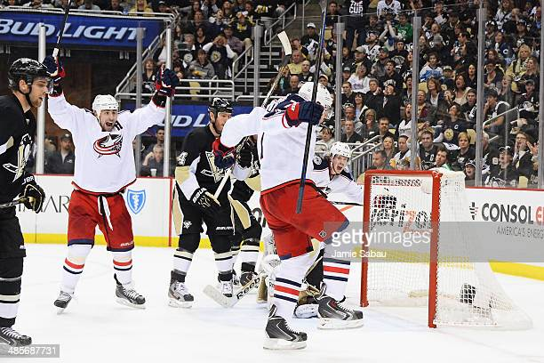 Brandon Dubinsky and Jack Johnson of the Columbus Blue Jackets celebrate Johnson's power play goal in the third period to send the game in to...