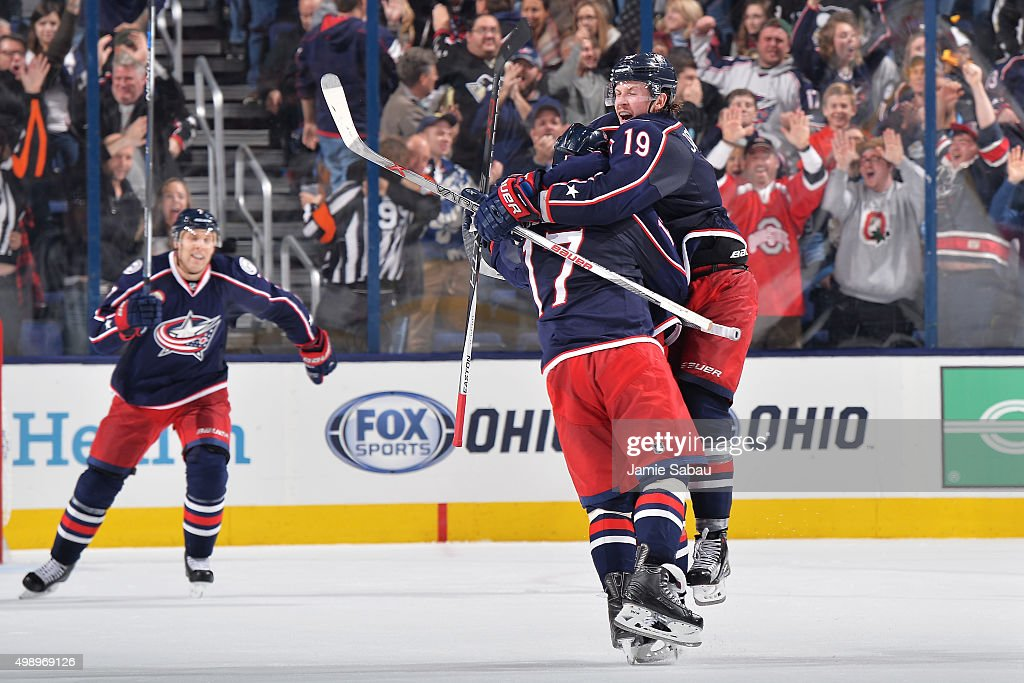 Brandon Dubinsky Cam Atkinson and Ryan Johansen of the Columbus Blue Jackets celebrate after scoring a goal in overtime against the Pittsburgh...