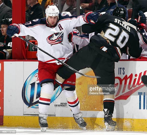 Brandon Dubinsky of the Columbus Blue Jackets and David Steckel of the Anaheim Ducks collide on February 3 2014 at Honda Center in Anaheim California