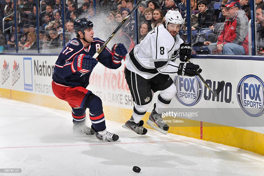Brandon Dubinsky #17 of the Columbus Blue Jackets and Drew Doughty #8 of the Los Angeles Kings chase down a loose puck in the first period on February 5, 2013 at Nationwide Arena in Columbus, Ohio.