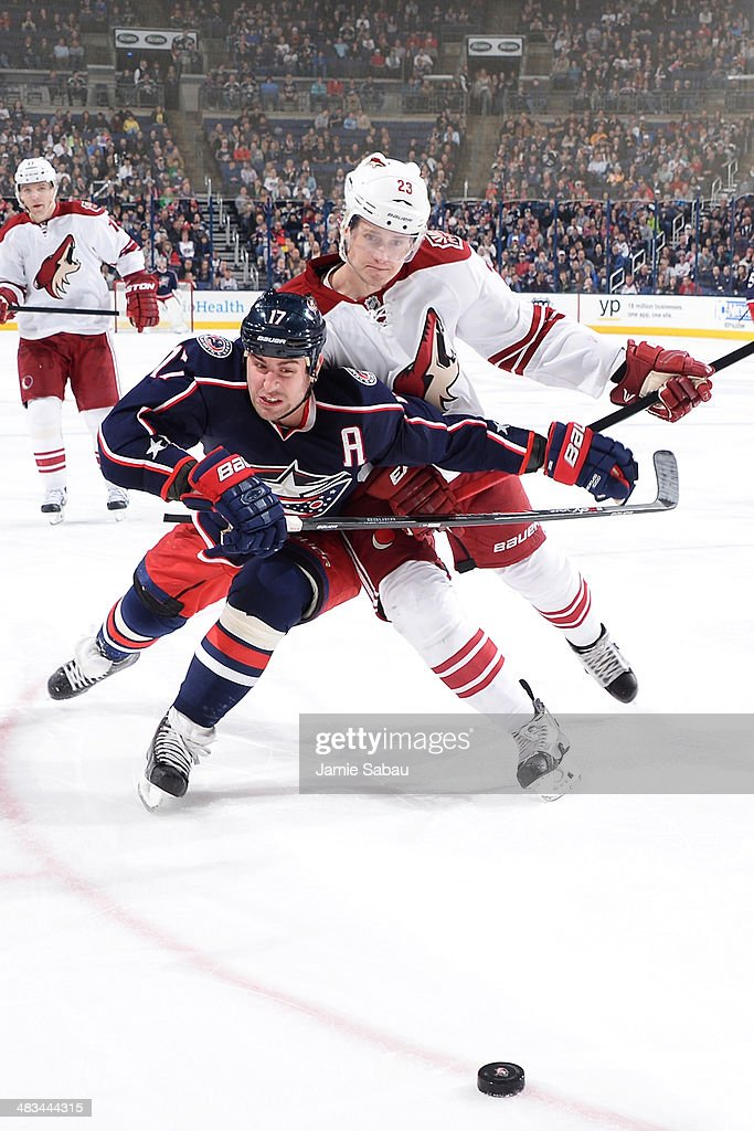 <a gi-track='captionPersonalityLinkClicked' href=/galleries/search?phrase=Brandon+Dubinsky&family=editorial&specificpeople=2271907 ng-click='$event.stopPropagation()'>Brandon Dubinsky</a> #17 of the Columbus Blue Jackets and <a gi-track='captionPersonalityLinkClicked' href=/galleries/search?phrase=Oliver+Ekman-Larsson&family=editorial&specificpeople=5894618 ng-click='$event.stopPropagation()'>Oliver Ekman-Larsson</a> #23 of the Phoenix Coyotes battle as they skate after the puck during the third period on April 8, 2014 at Nationwide Arena in Columbus, Ohio. Columbus defeated Phoenix 4-3 in overtime.