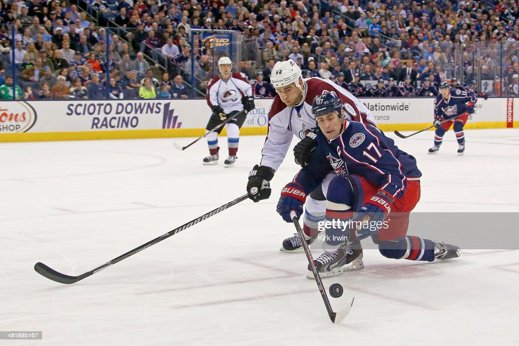 <a gi-track='captionPersonalityLinkClicked' href=/galleries/search?phrase=Brandon+Dubinsky&family=editorial&specificpeople=2271907 ng-click='$event.stopPropagation()'>Brandon Dubinsky</a> #17 of the Columbus Blue Jackets and <a gi-track='captionPersonalityLinkClicked' href=/galleries/search?phrase=Ryan+O%27Reilly&family=editorial&specificpeople=4754037 ng-click='$event.stopPropagation()'>Ryan O'Reilly</a> #90 of the Colorado Avalanche battle for control of the puck during the second period on April 1, 2014 at Nationwide Arena in Columbus, Ohio.