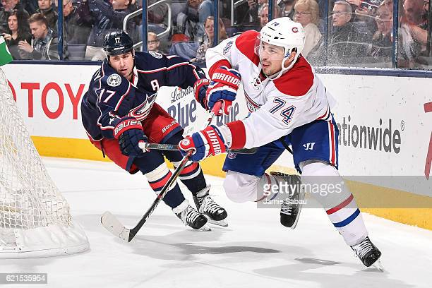 Brandon Dubinsky of the Columbus Blue Jackets chases after Alexei Emelin of the Montreal Canadiens on November 4 2016 at Nationwide Arena in Columbus...