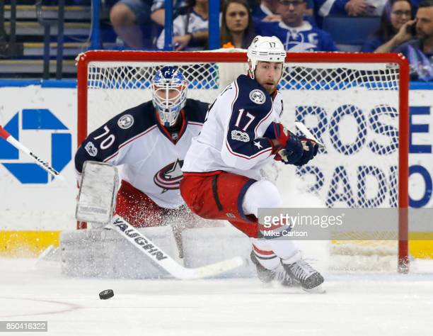 Brandon Dubinsky of the Columbus Blue Jackets looks at a loose puck in front of Joonas Korpisalo against the Tampa Bay Lightning at the Amalie Arena...