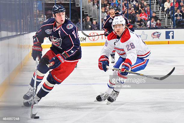 Brandon Dubinsky of the Columbus Blue Jackets skates the puck past Nathan Beaulieu of the Montreal Canadiens during the first period on February 26...