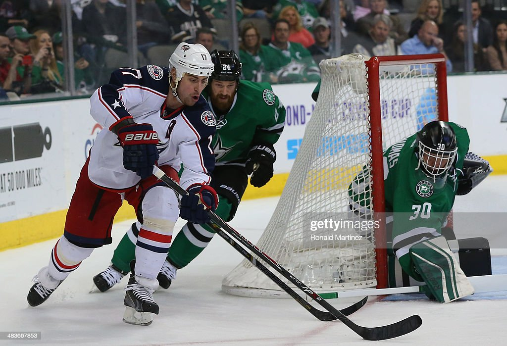 Brandon Dubinsky #17 of the Columbus Blue Jackets skates the puck past Jordie Benn #24 of the Dallas Stars in the second period at American Airlines Center on April 9, 2014 in Dallas, Texas.