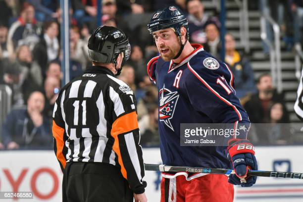 Brandon Dubinsky of the Columbus Blue Jackets speaks with referee Kelly Sutherland during a game against the Buffalo Sabres on March 10 2017 at...