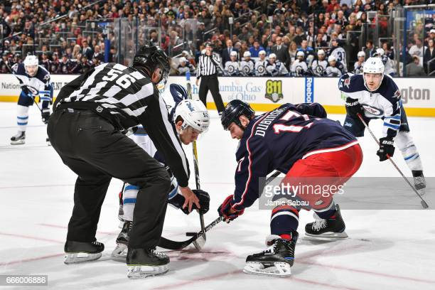 Brandon Dubinsky of the Columbus Blue Jackets takes a face off against Jack Roslovic of the Winnipeg Jets on April 6 2017 at Nationwide Arena in...