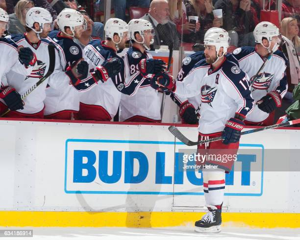 Brandon Dubinsky of the Columbus Blue Jackets taps gloves with teammates on the bench after scoring a goal during an NHL game against the Detroit Red...