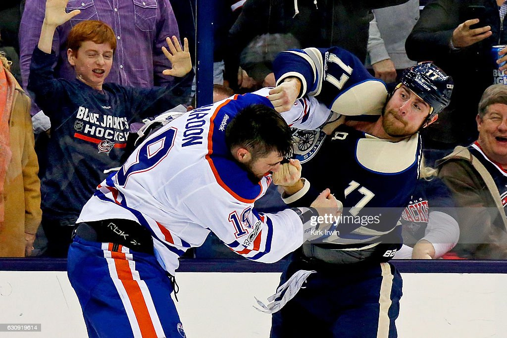 Brandon Dubinsky #17 of the Columbus Blue Jackets throws a punch while fighting with Patrick Maroon #19 of the Edmonton Oilers during the second period on January 3, 2017 at Nationwide Arena in Columbus, Ohio.