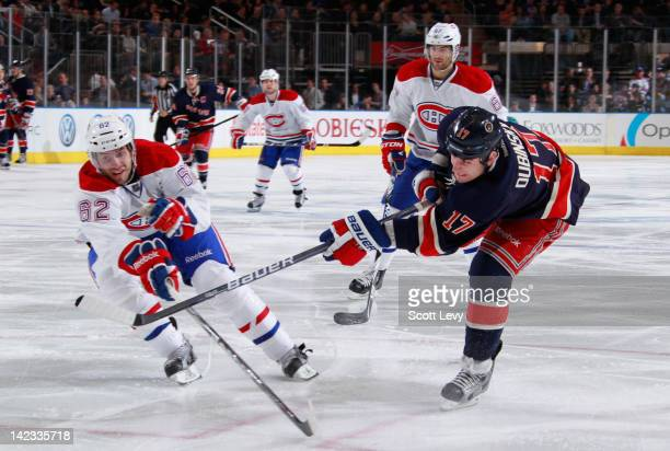 Brandon Dubinsky of the New York Rangers shoots the puck past against Frederic StDenis of the Montreal Canadiens at Madison Square Garden on March 30...