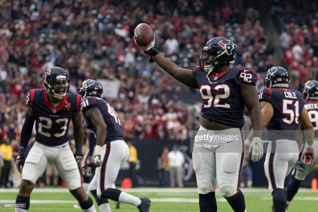 Brandon Dunn #92 of the Houston Texans celebrates with Kurtis Drummond #23 after recovering a fumble in the fourth quarter against the Tennessee Titans at NRG Stadium on October 1, 2017 in Houston, Texas.