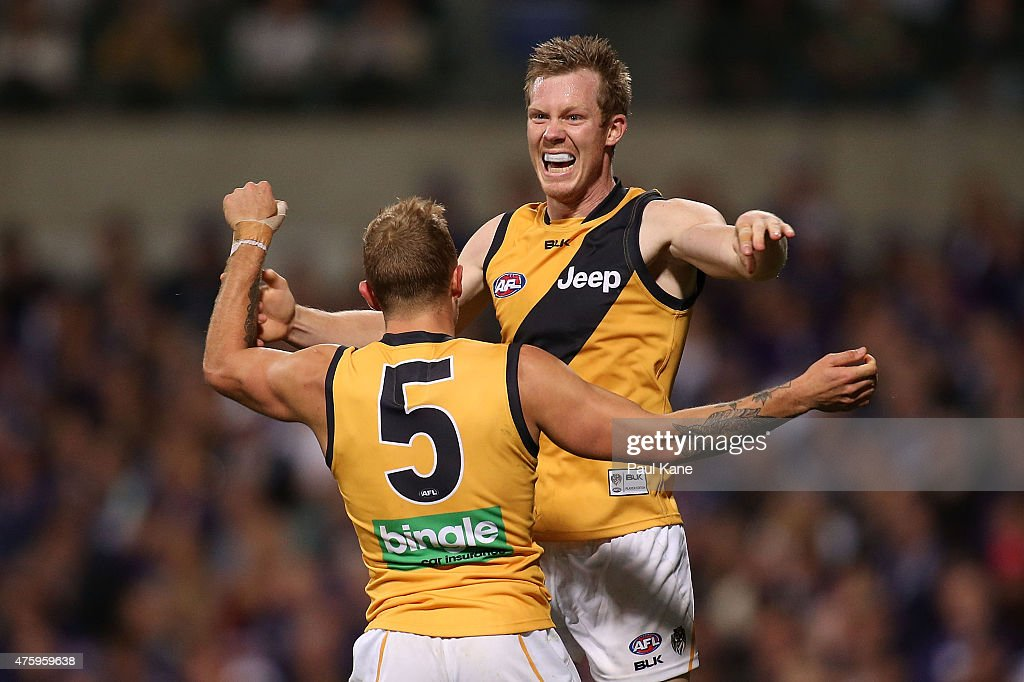 Brandon Ellis and Jack Riewoldt of the Tigers celebrate a goal during the round 10 AFL match between the Fremantle Dockers and the Richmond Tigers at...