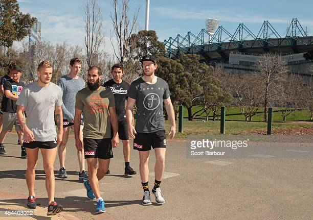 Brandon Ellis Dylan Grimes Bachar Houli and the Tigers talk as they walk around the MCG during a Richmond Tigers AFL recovery session on August 31...
