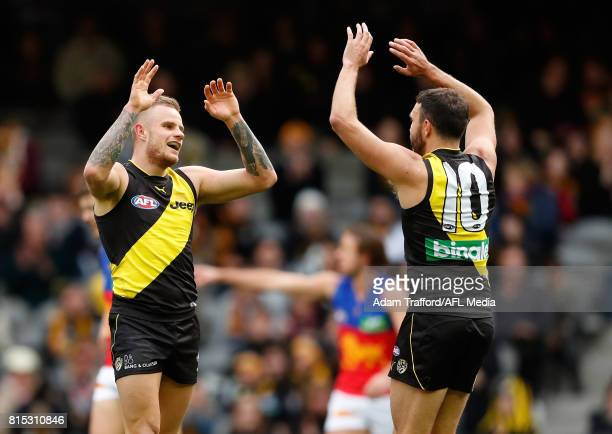 Brandon Ellis of the Tigers celebrates a goal with Shane Edwards of the Tigers during the 2017 AFL round 17 match between the Richmond Tigers and the...