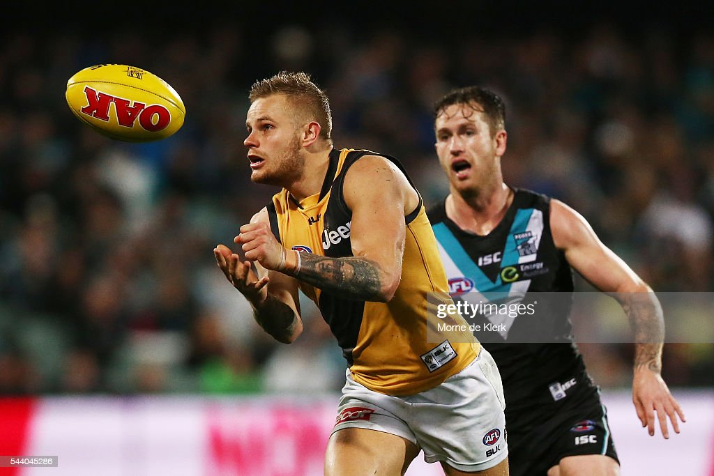 Brandon Ellis of the Tigers gets away from Cam O'Shea of the Power during the round 15 AFL match between the Port Adelaide Power and the Richmond Tigers at Adelaide Oval on July 1, 2016 in Adelaide, Australia.