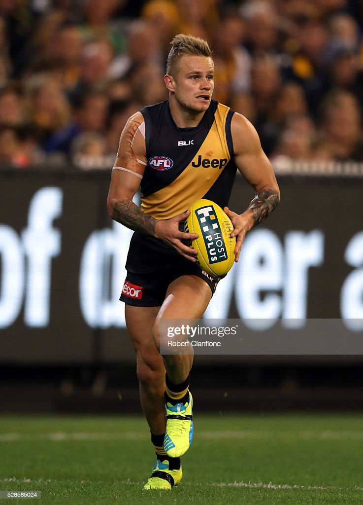 Brandon Ellis of the Tigers runs with the ball during the round seven AFL match between the Richmond Tigers and the Hawthorn Hawks at Melbourne Cricket Ground on May 6, 2016 in Melbourne, Australia.
