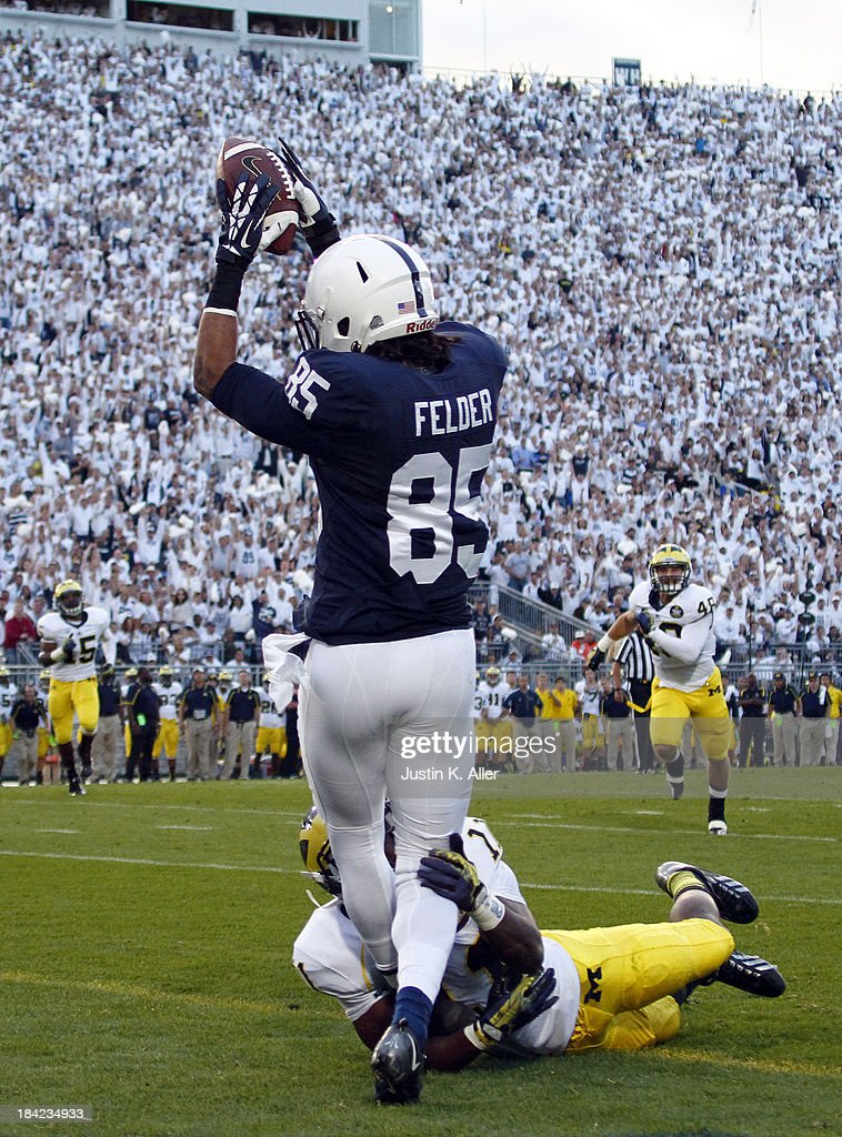 Brandon Felder #85 of the Penn State Nittany Lions catches a 24 yard touchdown pass against the Michigan Wolverines during the game on October 12, 2013 at Beaver Stadium in State College, Pennsylvania.