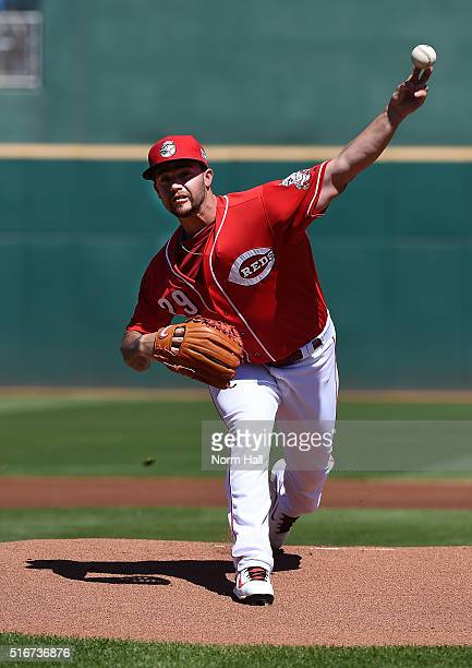 Brandon Finnegan of the Cincinnati Reds delivers a warmup pitch during the first inning against the Arizona Diamondbacks at Goodyear Ballpark on...