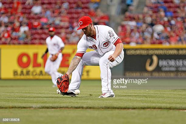 Brandon Finnegan of the Cincinnati Reds fields a bunted ball by Brandon Moss of the St Louis Cardinals during the seventh inning at Great American...