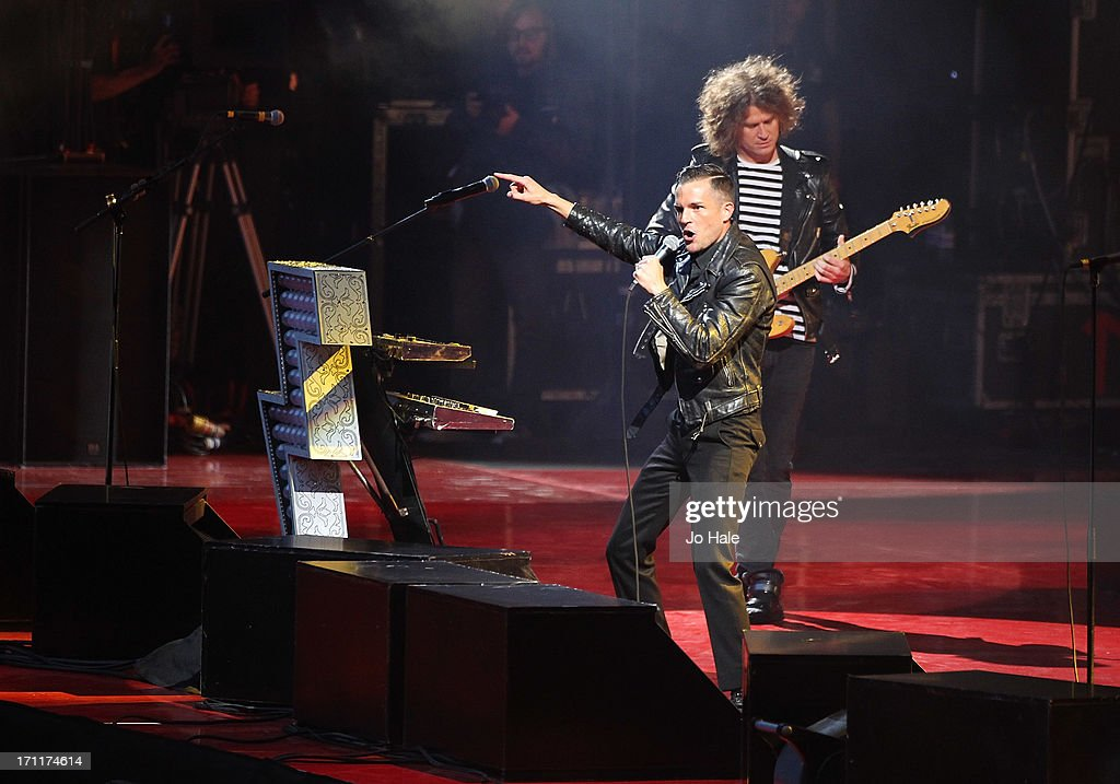 Brandon Flowers and Dave Keuning of The Killers perform on stage at Wembley Stadium on June 22, 2013 in London, England.