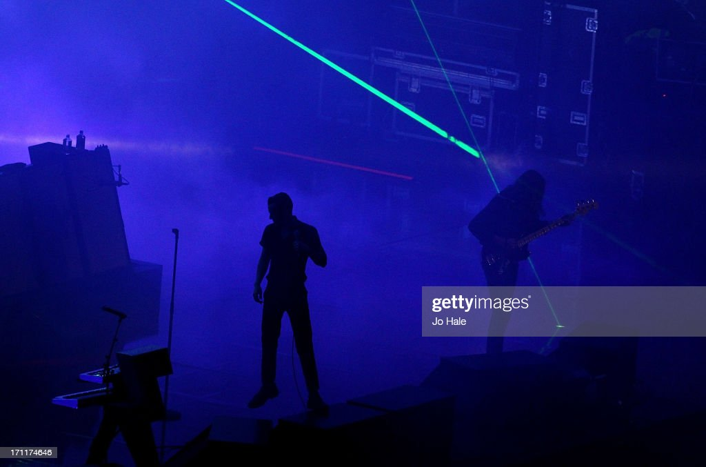 Brandon Flowers and <a gi-track='captionPersonalityLinkClicked' href=/galleries/search?phrase=Mark+Stoermer&family=editorial&specificpeople=234409 ng-click='$event.stopPropagation()'>Mark Stoermer</a> of The Killers perform on stage at Wembley Stadium on June 22, 2013 in London, England.