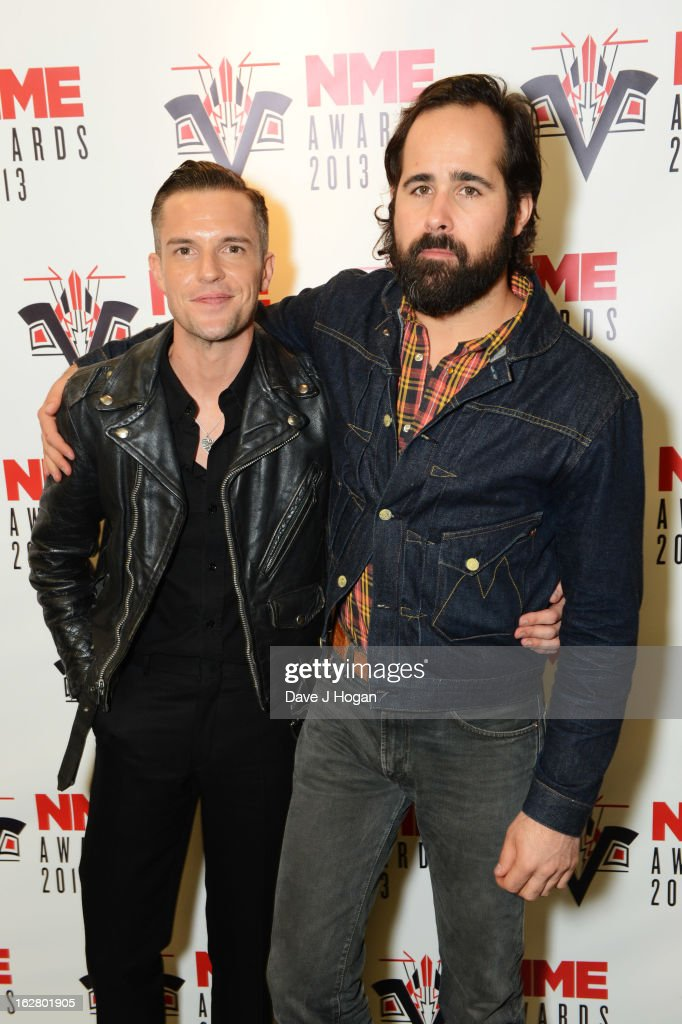 Brandon Flowers and <a gi-track='captionPersonalityLinkClicked' href=/galleries/search?phrase=Ronnie+Vannucci&family=editorial&specificpeople=228165 ng-click='$event.stopPropagation()'>Ronnie Vannucci</a> Jr of The Killers pose with the Best International Band Award in the media room at the NME Awards 2013 at The Troxy on February 27, 2013 in London, England.