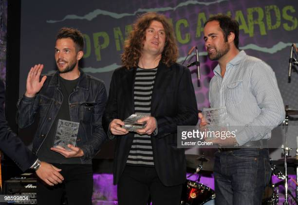 Brandon Flowers Dave Keuning and Ronnie Vannucci Jr of The Killers speak onstage at the 27th Annual ASCAP Pop Music Awards held at the Renaissance...