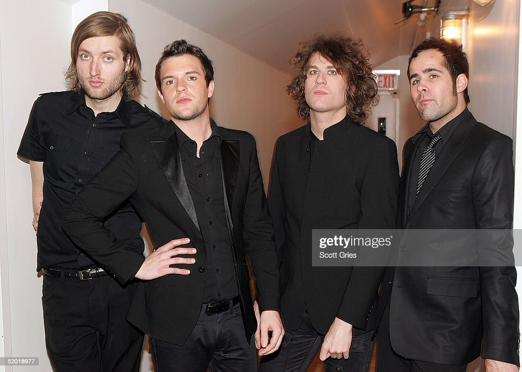 Brandon Flowers Mark Stoermer David Keuning and Ronnie Vannucci of The Killers pose for a photo backstage during MTV's Total Request Live at the MTV...