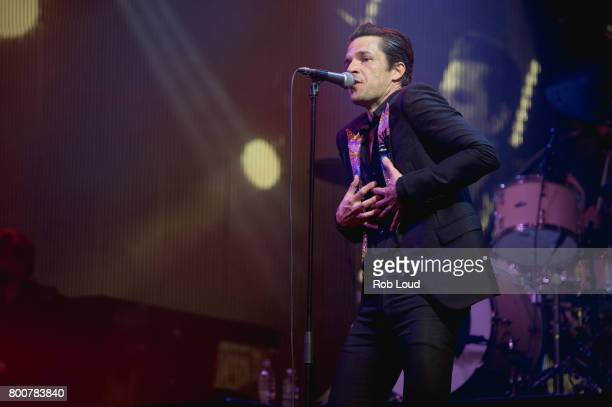 Brandon Flowers of The Killers performs a surprise concert at Glastonbury Festival Site on June 25 2017 in Glastonbury England