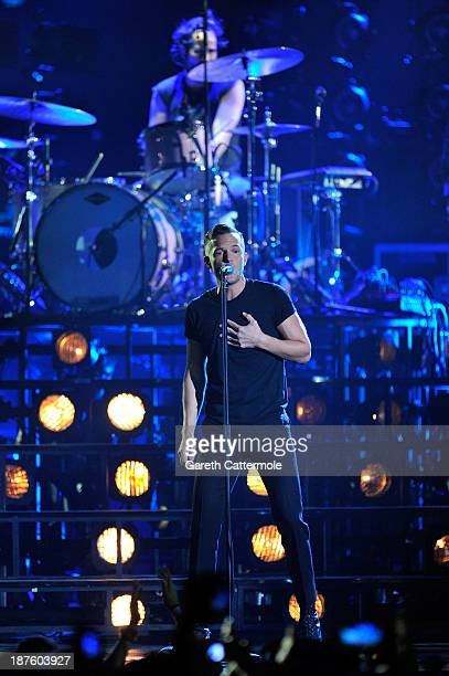 Brandon Flowers of The Killers performs onstage during the MTV EMA's 2013 at the Ziggo Dome on November 10 2013 in Amsterdam Netherlands