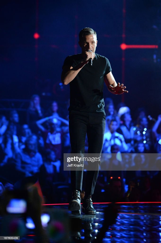 Brandon Flowers of The Killers performs onstage during the MTV EMA's 2013 at the Ziggo Dome on November 10, 2013 in Amsterdam, Netherlands.