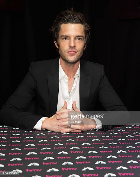 Brandon Flowers poses and signs copies of his New Album 'The Desired Effect' for Fans at at HMV Oxford Street on May 22 2015 in London England