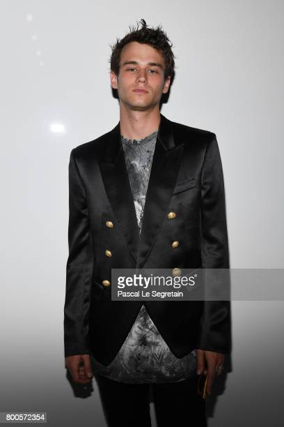 Brandon Flynn attends the Balmain Menswear Spring/Summer 2018 show as part of Paris Fashion Week on June 24 2017 in Paris France