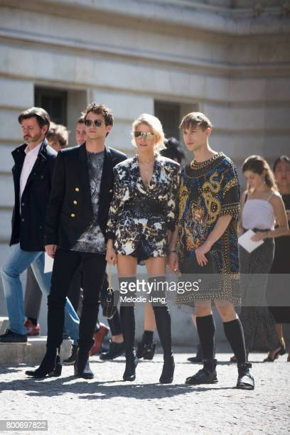 Brandon Flynn Caroline Daur Tommy Dorfman outside the Balmain show on June 24 2017 in Paris France