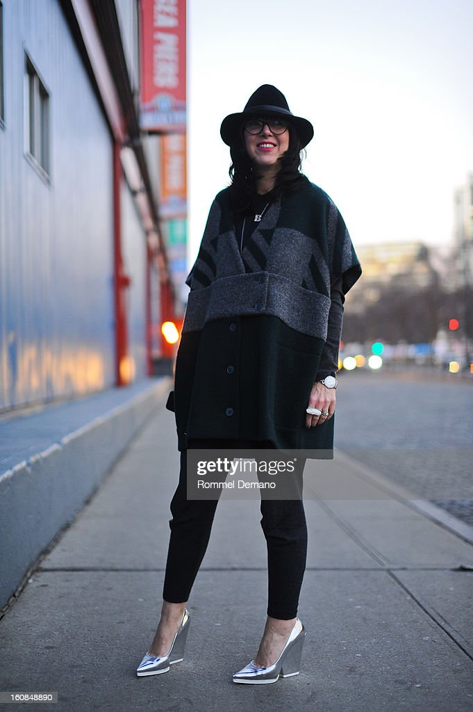 Brandon Frein, a blogger from Chicago, attends the Rachel Comey show wearing Goorin Brothers hat, Cacharel coat and Celine shoes on February 6, 2013 in New York City.
